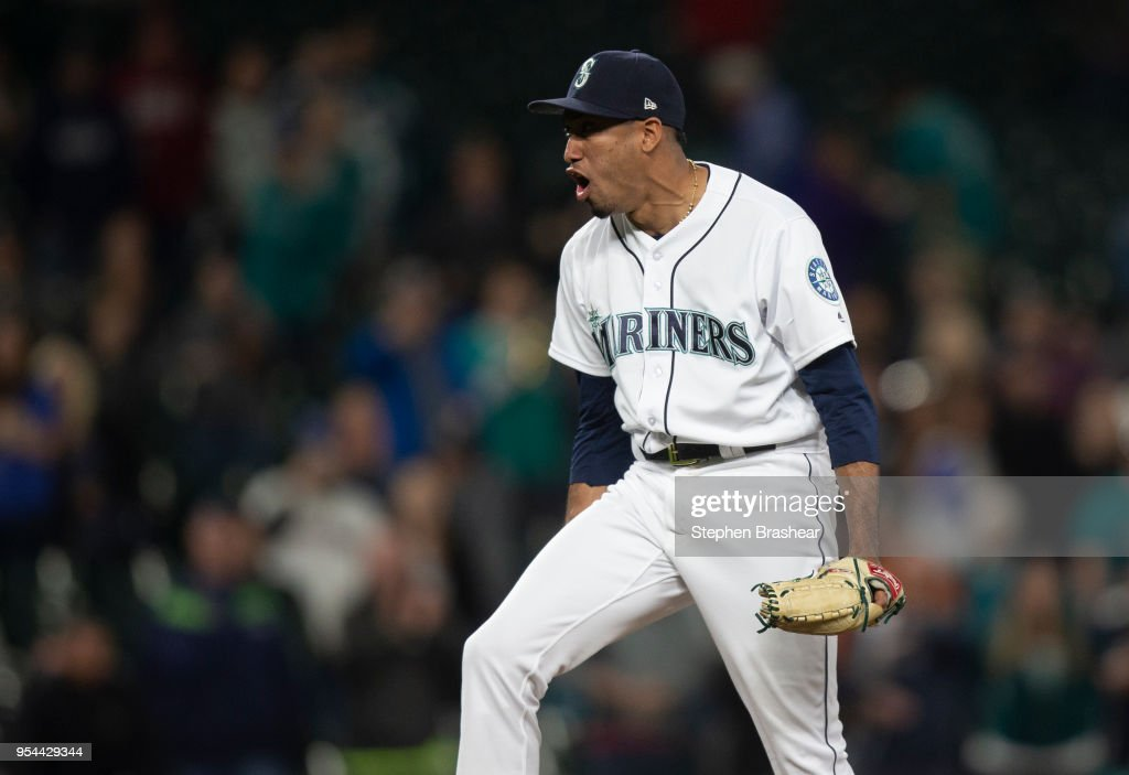 Relief pitcher Edwin Diaz #39 of the Seattle Mariners celebrates after getting the last out to earn the save against the Oakland Athletics at Safeco Field on May 3, 2018 in Seattle, Washington. The Mariners won the game 4-1.