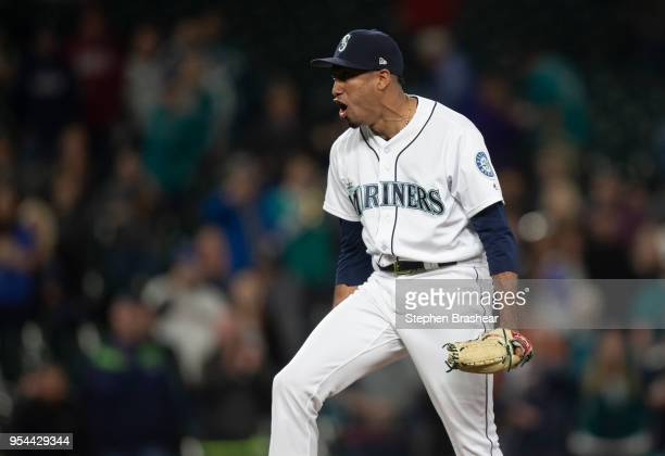 Relief pitcher Edwin Diaz of the Seattle Mariners celebrates after getting the last out to earn the save against the Oakland Athletics at Safeco...