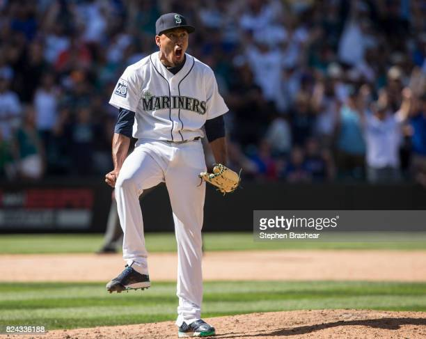 Relief pitcher Edwin Diaz of the Seattle Mariners reacts after the last out of an interleague game against the New York Mets at Safeco Field on July...