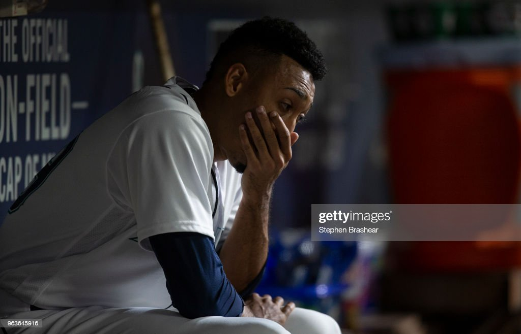 Relief pitcher Edwin Diaz #39 of the Seattle Mariners sits in the dugout after giving up three runs during the ninth inning against the Texas Rangers at Safeco Field on May 29, 2018 in Seattle, Washington.