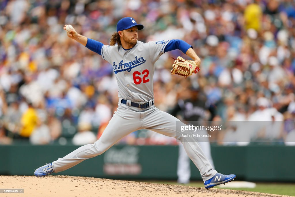Relief pitcher Erik Goeddel #62 of the Los Angeles Dodgers delivers to home plate during the third inning against the Colorado Rockies at Coors Field on June 3, 2018 in Denver, Colorado.
