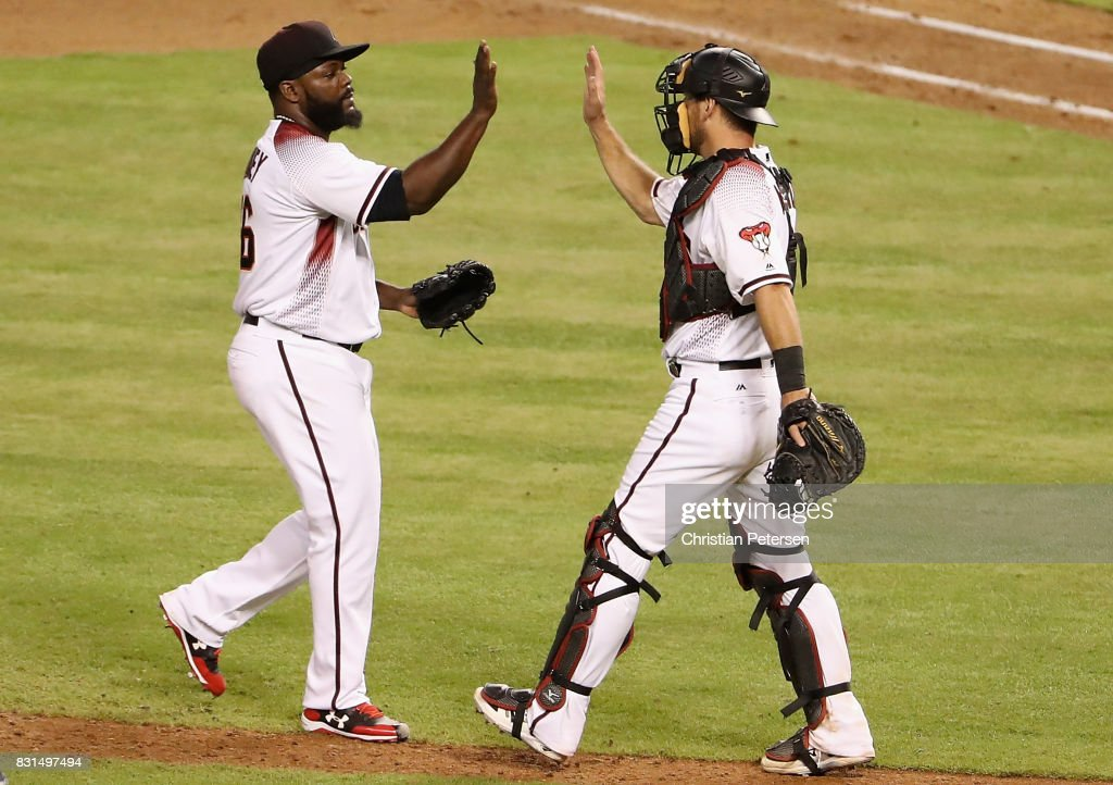 Relief pitcher Fernando Rodney #56 of the Arizona Diamondbacks celebrates with catcher Jeff Mathis #2 after defeating the Houston Astros in the MLB game at Chase Field on August 14, 2017 in Phoenix, Arizona. The Diamondbacks defeated the Astros 2-0.