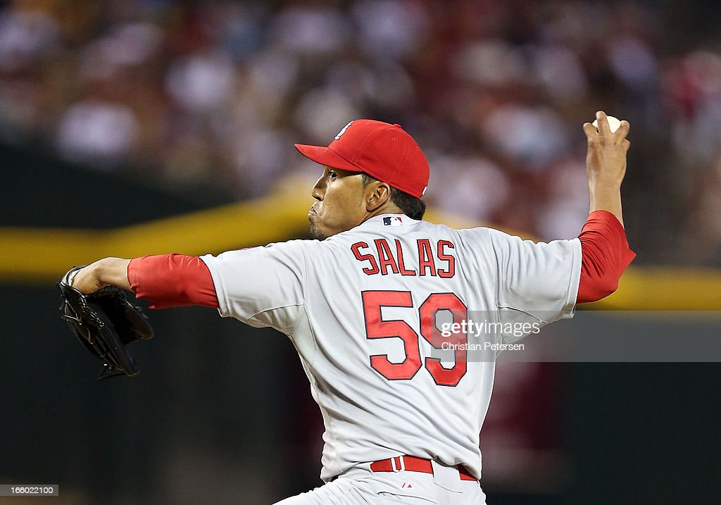 Relief pitcher Fernando Salas #59 of the St. Louis Cardinals pitches against the Arizona Diamondbacks during the MLB Opening Day game at Chase Field on April 1, 2013 in Phoenix, Arizona. The Diamondbacks defeated the Cardinals 6-2.