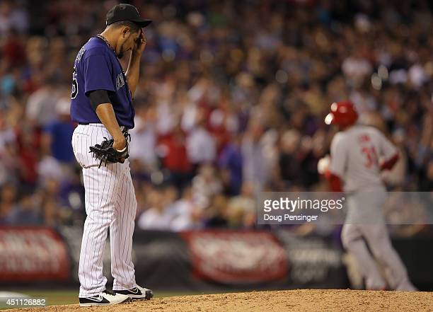 Relief pitcher Franklin Morales of the Colorado Rockies reacts as he returns the mound as the bases clear on a three run home run by Matt Adams of...