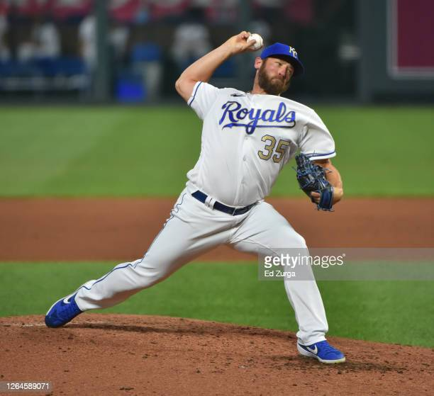Relief pitcher Greg Holland of the Kansas City Royals throws a pitch in the fifth inning against the Minnesota Twins at Kauffman Stadium on August...