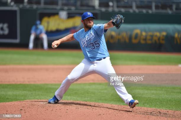 Relief pitcher Greg Holland of the Kansas City Royals throws in the sixth inning Minnesota Twins at Kauffman Stadium on August 9, 2020 in Kansas...