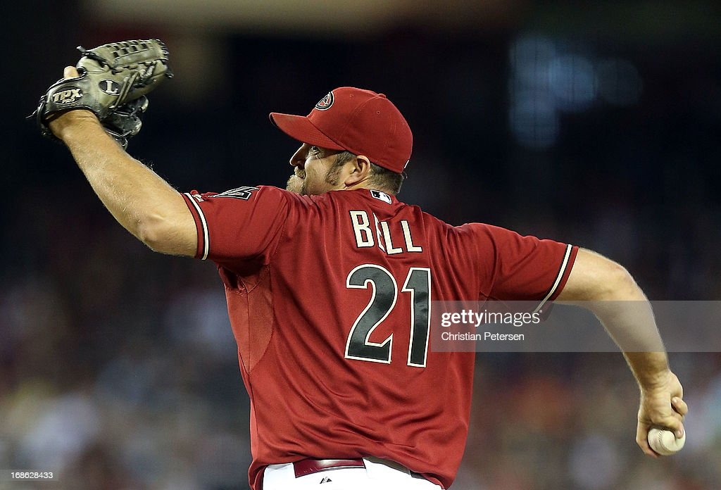 Relief pitcher Heath Bell #21 of the Arizona Diamondbacks pitches against the Philadelphia Phillies during the MLB game at Chase Field on May 12, 2013 in Phoenix, Arizona. The Phillies defeated the Diamondbacks 4-2 in 10 innings.