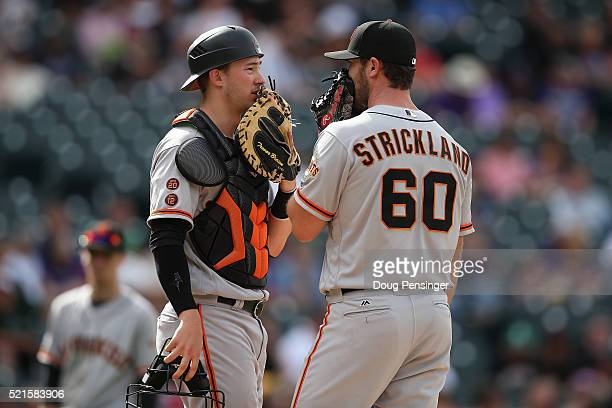 Relief pitcher Hunter Strickland of the San Francisco Giants talks with catcher Trevor Brown of the San Francisco Giants as they work against the...