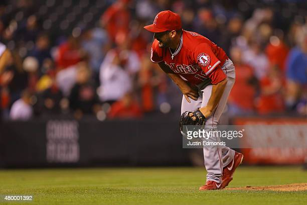 Relief pitcher Huston Street of the Los Angeles Angels of Anaheim appears to injure himself on the final out of the game in the ninth inning against...