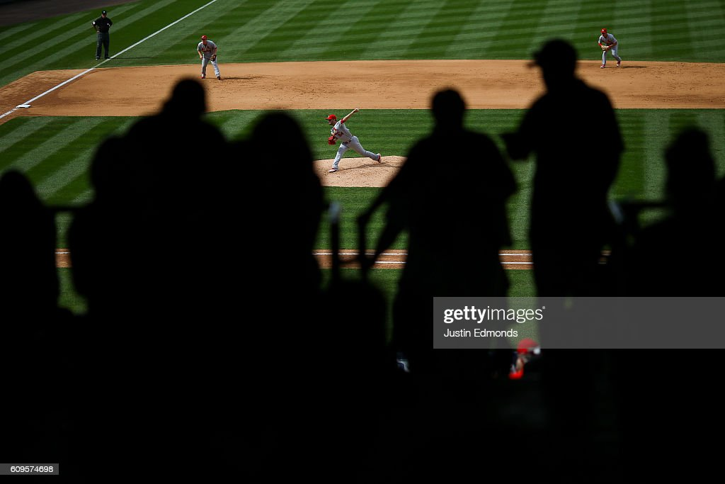 Relief pitcher Jaime Garcia #54 of the St. Louis Cardinals delivers to home plate during the fifth inning as Jedd Gyorko #3 and Aledmys Diaz #36 prepare for the play against the Colorado Rockies at Coors Field on September 21, 2016 in Denver, Colorado.
