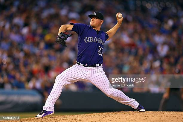 Relief pitcher Jake McGee of the Colorado Rockies delivers to home plate during the seventh inning against the Philadelphia Phillies at Coors Field...