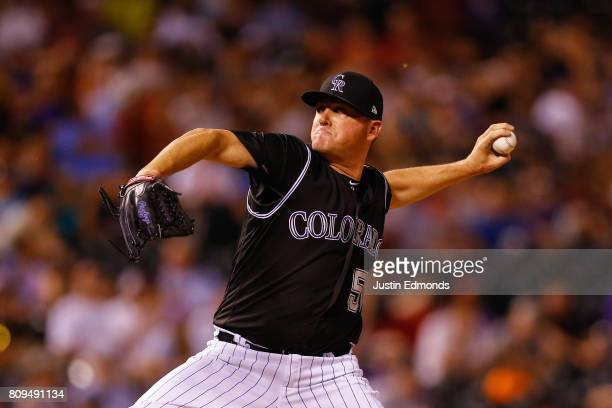 Relief pitcher Jake McGee of the Colorado Rockies delivers to home plate during the eighth inning against the Cincinnati Reds at Coors Field on July...