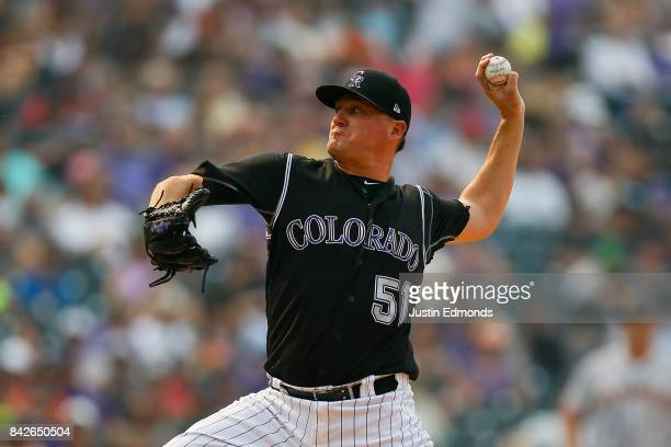 Relief pitcher Jake McGee of the Colorado Rockies delivers to home plate during the eighth inning against the San Francisco Giants at Coors Field on...