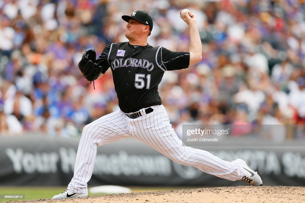Relief pitcher Jake McGee #51 of the Colorado Rockies delivers to home plate during the eighth inning against the Los Angeles Dodgers at Coors Field on June 3, 2018 in Denver, Colorado.