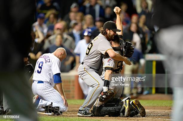 Relief pitcher Jason Grilli and catcher Russell Martin of the Pittsburgh Pirates celebrate after Martin tagged out Nate Schierholtz of the Chicago...
