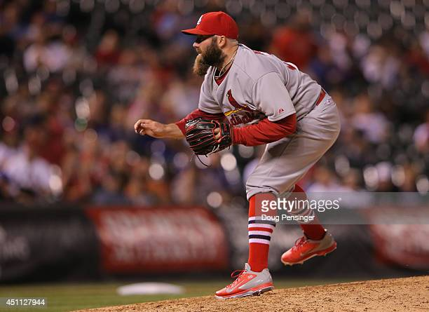 Relief pitcher Jason Motte of the St Louis Cardinals delivers to Troy Tulowitzki of the Colorado Rockies in the ninth inning at Coors Field on June...