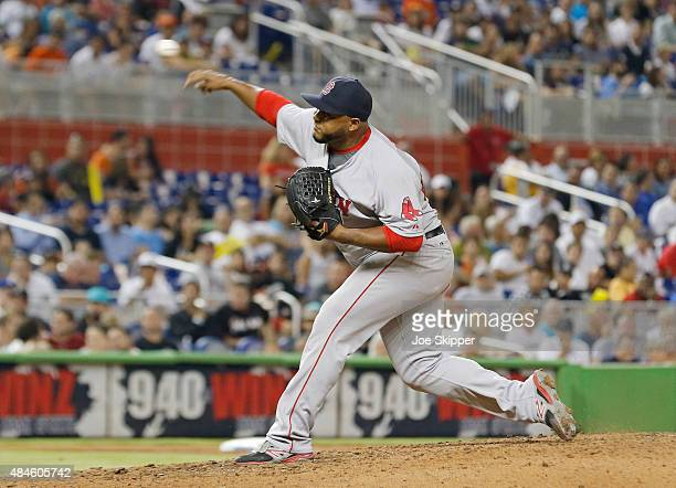 Relief pitcher Jean Machi of the Boston Red Sox throws against the Miami Marlins in the eighth inning at Marlins Park on August 11 2015 in Miami...
