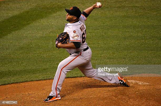 Relief pitcher Jean Machi of the San Francisco Giants delivers against the Colorado Rockies at Coors Field on May 22 2015 in Denver Colorado The...