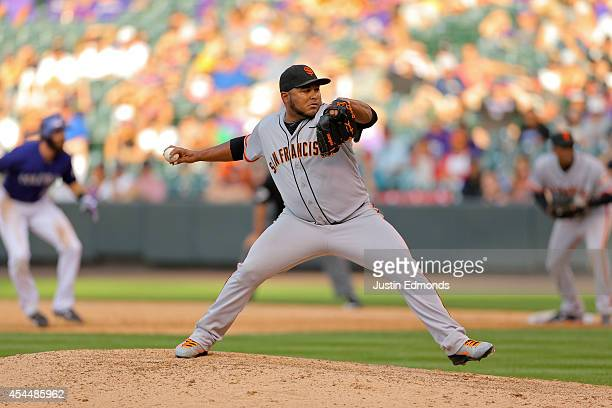 Relief pitcher Jean Machi of the San Francisco Giants delivers to home plate during the sixth inning against the Colorado Rockies at Coors Field on...