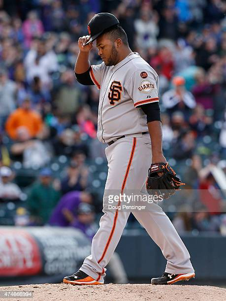Relief pitcher Jean Machi of the San Francisco Giants returns to the mound after giving up a three run home run to Nolan Arenado of the Colorado...