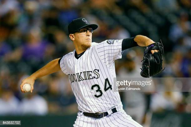 Relief pitcher Jeff Hoffman of the Colorado Rockies delivers to home plate during the sixth inning against the San Francisco Giants at Coors Field on...