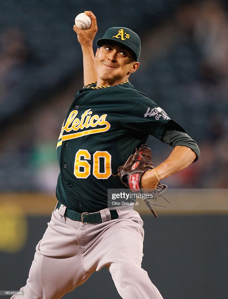 Relief pitcher Jesse Chavez #60 of the Oakland Athletics pitches in the sixth inning against the Seattle Mariners at Safeco Field on September 29, 2013 in Seattle, Washington. The Athletics defeated the Mariners 9-0.