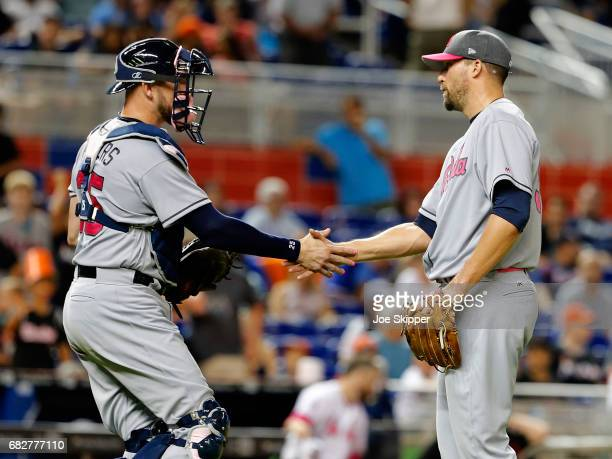 Relief pitcher Jim Johnson of the Atlanta Braves celebrates with catcher Tyler Flowers after their team defeated the Miami Marlins 31 at Marlins Park...