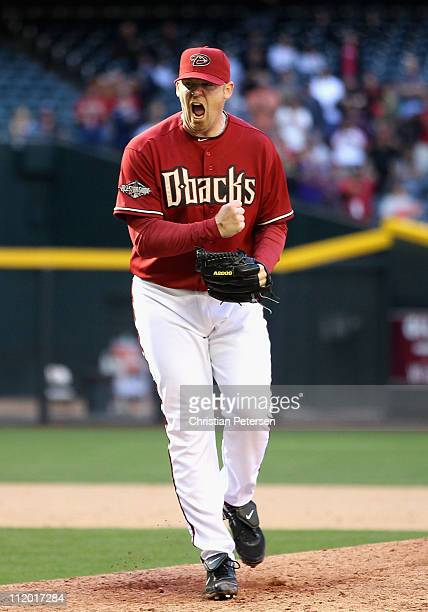 Relief pitcher JJ Putz of the Arizona Diamondbacks celebrates after defeating the Cincinnati Reds in the Major League Baseball game at Chase Field on...