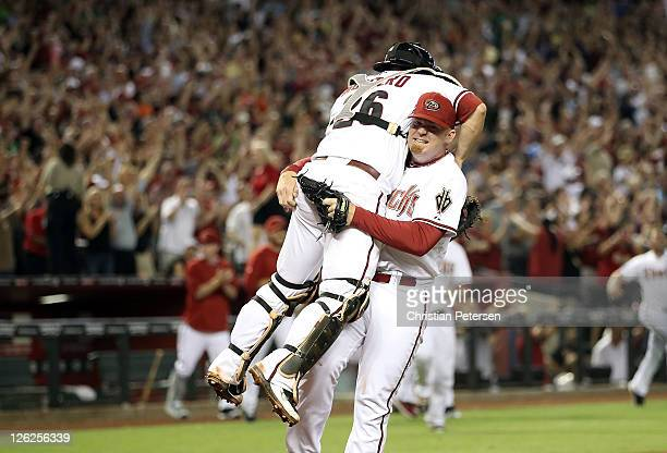 Relief pitcher JJ Putz of the Arizona Diamondbacks celebrates with catcher Miguel Montero after defeating the San Francisco Giants and clinching the...