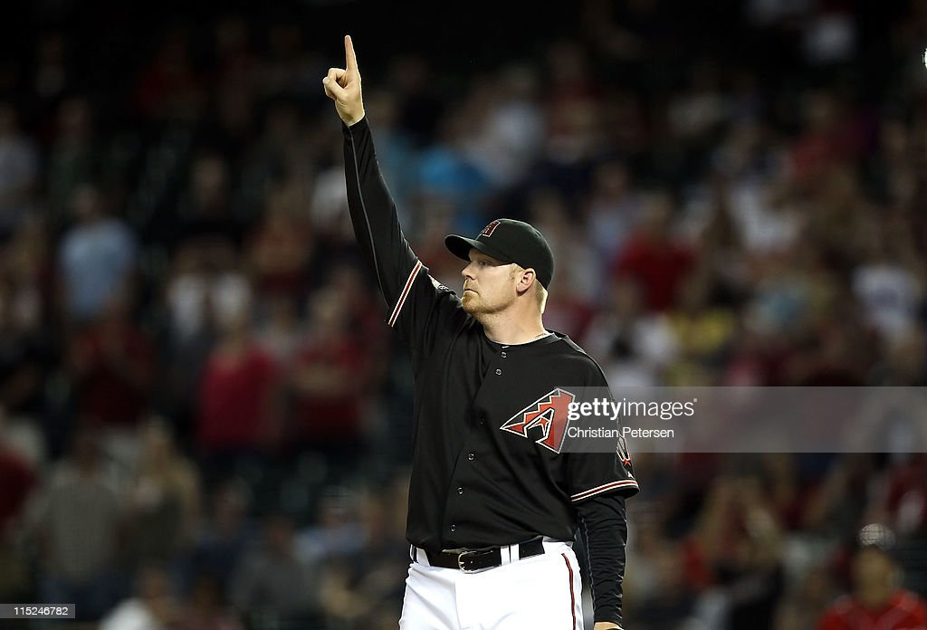 Relief pitcher J.J. Putz #40 of the Arizona Diamondbacks points to a fly ball during the ninth inning of the Major League Baseball game against the Washington Nationals at Chase Field on June 4, 2011 in Phoenix, Arizona. The Diamondbacks defeated the Nationals 2-0.