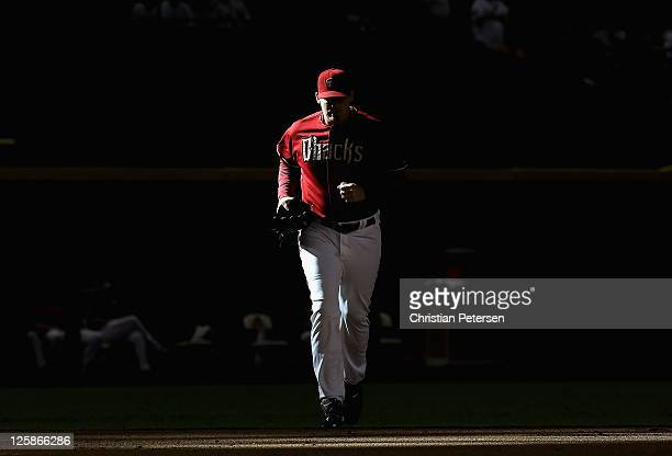 Relief pitcher JJ Putz of the Arizona Diamondbacks runs out of the bullpen to pitch against the Pittsburgh Pirates during the ninth inning of the...
