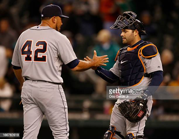 Relief pitcher Joaquin Benoit of the Detroit Tigers celebrates with catcher Alex Avila after defeating the Seattle Mariners 62 at Safeco Field on...
