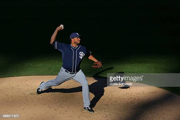 Relief pitcher Joaquin Benoit of the San Diego Padres delivers to home plate during the eighth inning against the Colorado Rockies at Coors Field on...