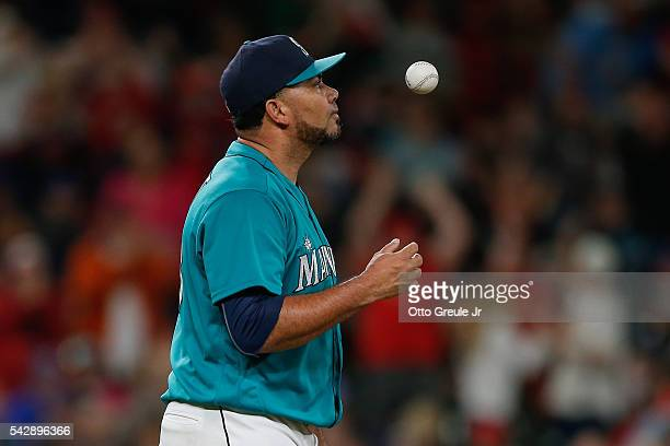 Relief pitcher Joaquin Benoit of the Seattle Mariners reacts after hitting Aledmys Diaz of the St Louis Cardinals with the bases loaded to tie the...