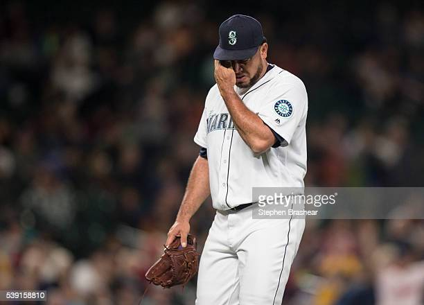 Relief pitcher Joaquin Benoit of the Seattle Mariners walks off the field after being pulled during the eighth inning of a game against the Cleveland...