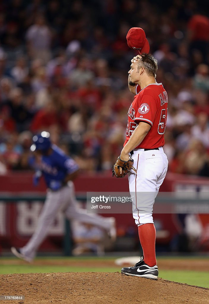Relief pitcher Joe Blanton #55 of the Los Angeles Angels of Anaheim looks on after giving up a two-run home run to Adrian Beltre of the Texas Rangers in the sixth inning at Angel Stadium of Anaheim on August 7, 2013 in Anaheim, California.