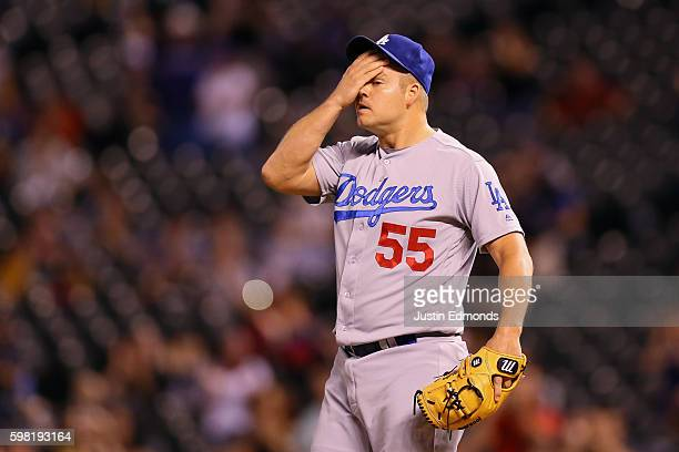 Relief pitcher Joe Blanton of the Los Angeles Dodgers reacts after giving up a two run home run to Nolan Arenado of the Colorado Rockies during the...