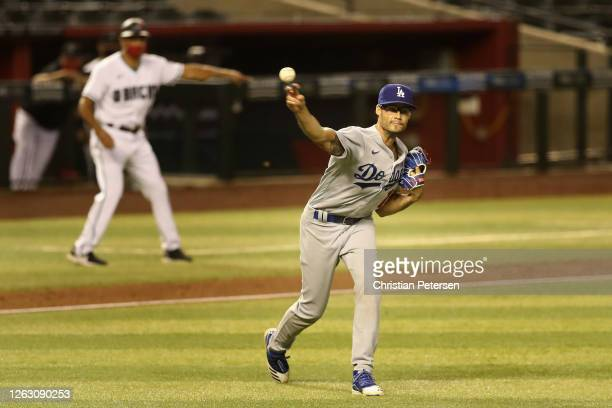 Relief pitcher Joe Kelly of the Los Angeles Dodgers fields a ground ball out against the Arizona Diamondbacks during the eighth inning of the MLB...