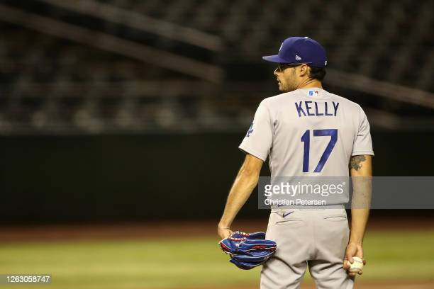 Relief pitcher Joe Kelly of the Los Angeles Dodgers pitches against the Arizona Diamondbacks during the seventh inning of the MLB game at Chase Field...