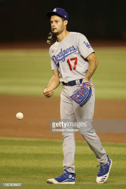Relief pitcher Joe Kelly of the Los Angeles Dodgers throws a ball in as he pitches against the Arizona Diamondbacks during the seventh inning of the...