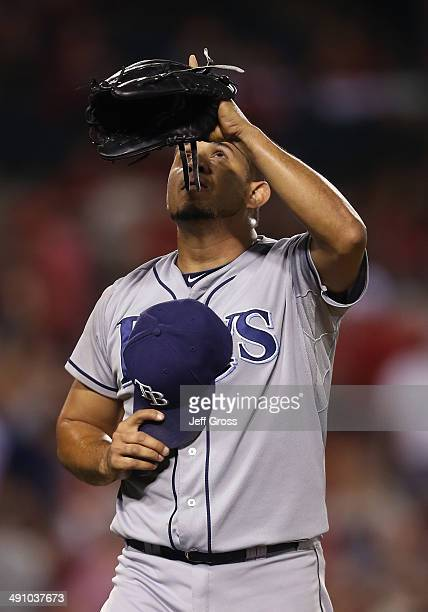 Relief pitcher Joel Peralta of the Tampa Bay Rays points skyward after striking out Howie Kendrick of the Los Angeles Angels of Anaheim to end the...