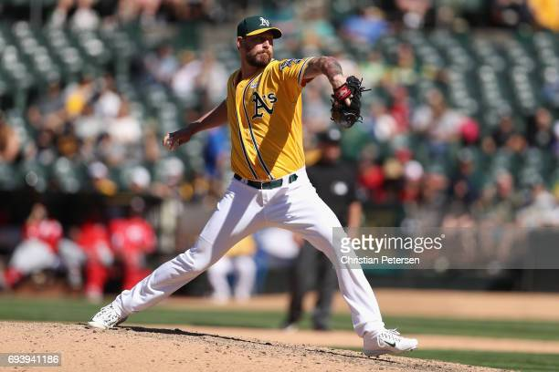 Relief pitcher John Axford of the Oakland Athletics pitches against the Washington Nationals during the MLB game at Oakland Coliseum on June 3 2017...