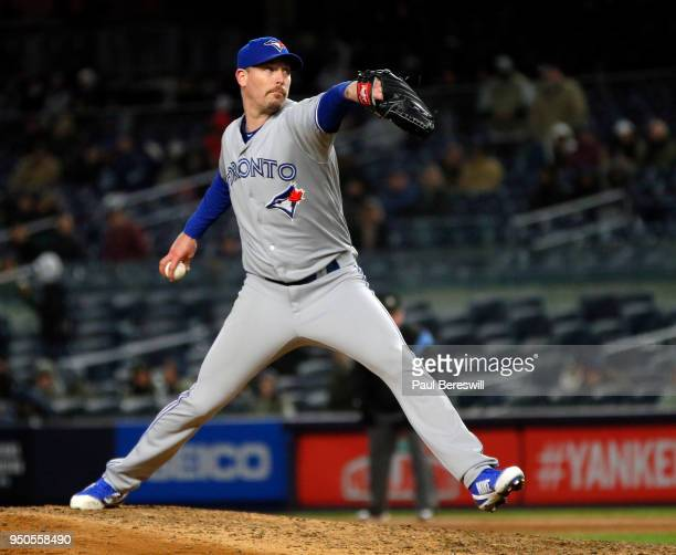 Relief pitcher John Axford of the Toronto Blue Jays pitches in an MLB baseball game against the New York Yankees on April 19 2018 at Yankee Stadium...