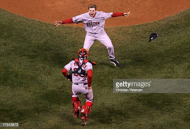 Relief pitcher Jonathan Papelbon of the Boston Red Sox celebrates with Jason Varitek after defeating the Colorado Rockies in Game Four of the 2007...