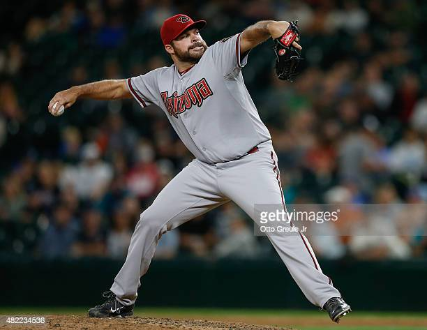 Relief pitcher Josh Collmenter of the Arizona Diamondbacks pitches in the ninth inning against the Seattle Mariners at Safeco Field on July 28 2015...