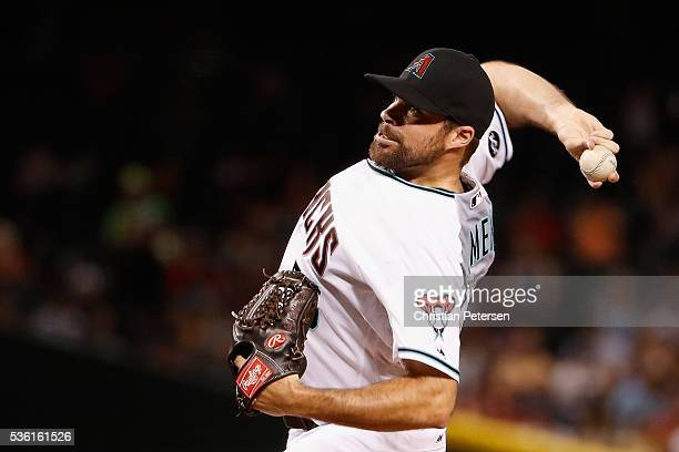 Relief pitcher Josh Collmenter of the Arizona Diamondbacks pitches against the San Diego Padres during the sixth inning of the MLB game at Chase...