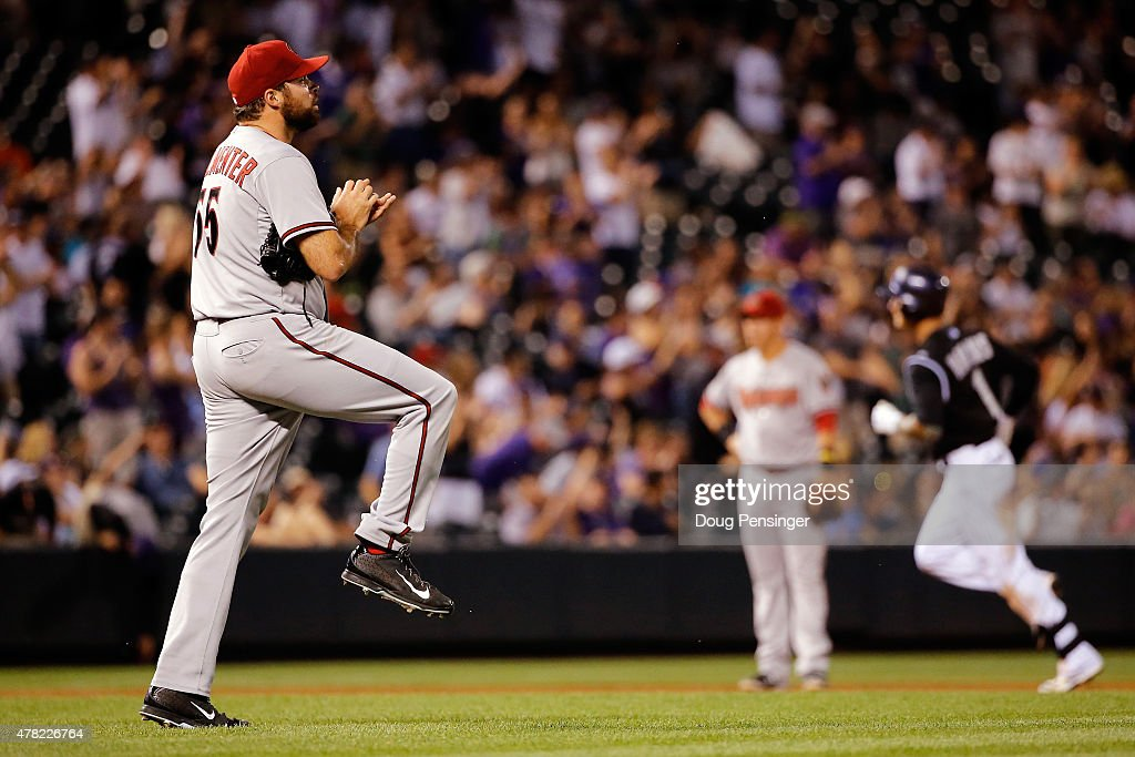Relief pitcher Josh Collmenter #55 of the Arizona Diamondbacks returns to the mound after giving up a solo home run to Brandon Barnes #1 of the Colorado Rockies to give the Rockies a 10-5 lead in the eighth inning at Coors Field on June 23, 2015 in Denver, Colorado.