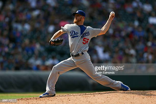 Relief pitcher JP Howell of the Los Angeles Dodgers delivers to home plate during the eighth inning against the Colorado Rockies at Coors Field on...