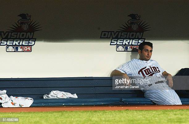 Relief pitcher Juan Rincon of the Minnesota Twins sits on the bench after giving up the game tying three run home run to Ruben Sierra of the New York...