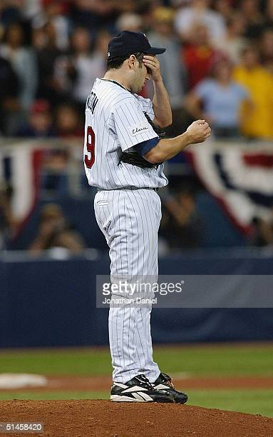 Relief pitcher Juan Rincon of the Minnesota Twins stands dejected on the mound after giving up the game tying three run home run to Ruben Sierra of...